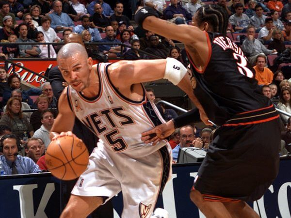 Jason Kidd drives against Allen Iverson