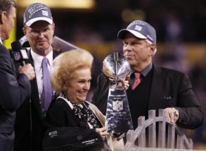 New York Giants owners Steve Tisch and John Mara celebrate their team's win with Mara's mother Ann Mara at the end of the NFL Super Bowl XLVI football game in Indianapolis