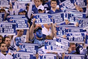 hi-res-96144327-fans-of-the-indianapolis-colts-hold-up-signs-before-the_crop_north