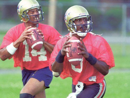Ottawa Roughriders Marquel Fleetwood (#14), left, and Danny Barrett (#8) at practice, July 18, 1994. (Chris Mikula/Ottawa Citizen), neg. 94-5986